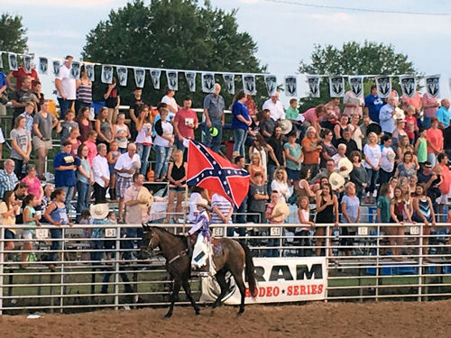 The Battleflag is carried around the Rodeo Arena while Dixie is played.